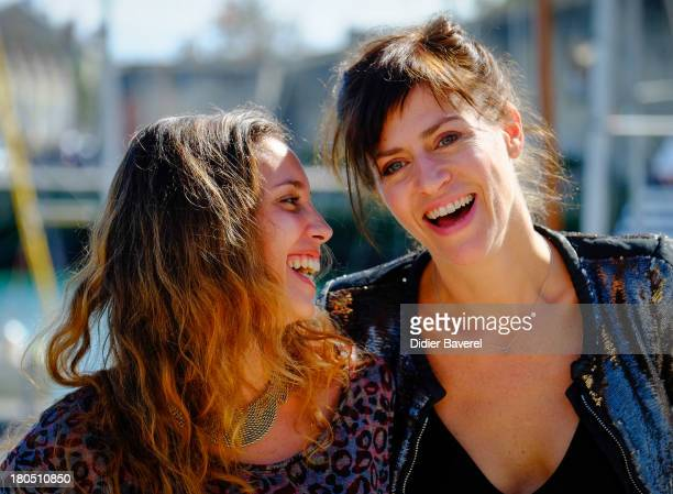 Actresses Anne Caillon and Lise Schreiber pose during the photocall of 'Dos Au Mur' at 15th Festival of TV Fiction on September 13 2013 in La...