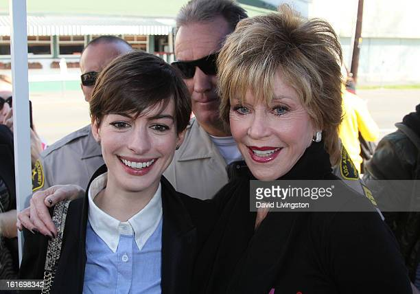 Actresses Anne Hathaway and Jane Fonda attend the kickoff for One Billion Rising in West Hollywood on February 14 2013 in West Hollywood California