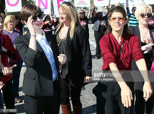 Actresses Anne Hathaway and Marisa Tomei attend the kickoff for One Billion Rising in West Hollywood on February 14 2013 in West Hollywood California
