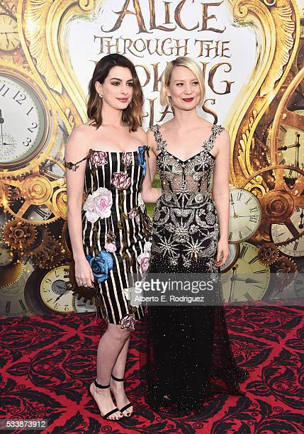 Actresses Anne Hathaway and Mia Wasikowska attend Disney's 'Alice Through the Looking Glass' premiere with the cast of the film which included Johnny...
