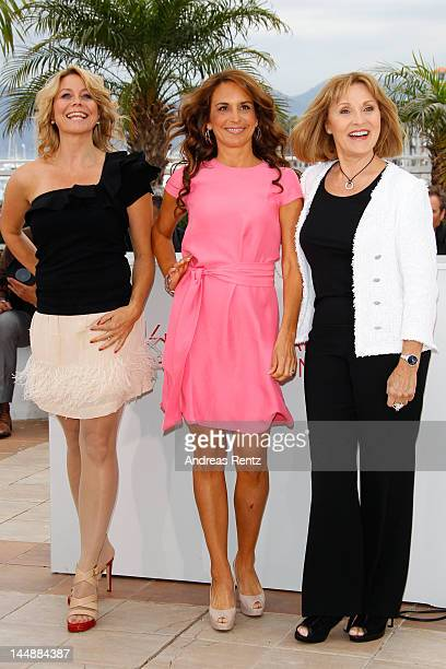 Actresses Anne Louise Hassing Alexandra Rapaport and Susse Wold pose at the Jagten Photocall during the 65th Annual Cannes Film Festival at Palais...