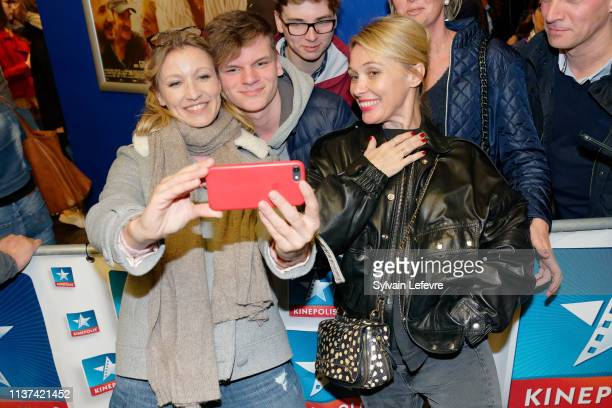 Actresses Anne Marivin and Alexandra Lamy pose for selfies with publicc as they attend the 'Chamboultout' Premiere on March 21 2019 in Lille France