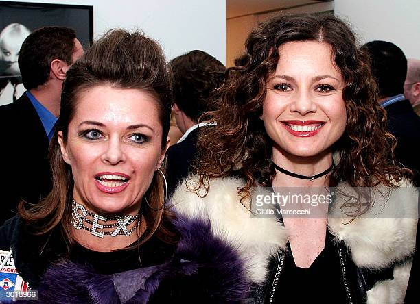 Actresses Antonella Elia and Sabrina Bertaccini attend the opening reception of Andy Warhol and Helmut Newton's work on February 26, 2004 at Gagosian...