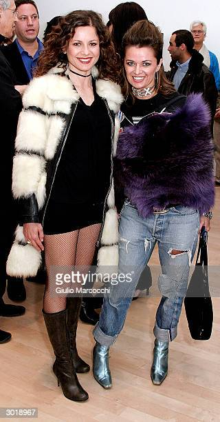 Actresses Antonella Elia and Sabrina Bertaccini attend the opening reception of Andy Warhol and Helmut Newton's work on February 26 2004 at Gagosian...