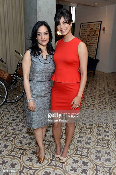 Actresses Archie Panjabi and Morena Baccarin attend the Variety Emmy Studio at Palihouse on May 30 2013 in West Hollywood California
