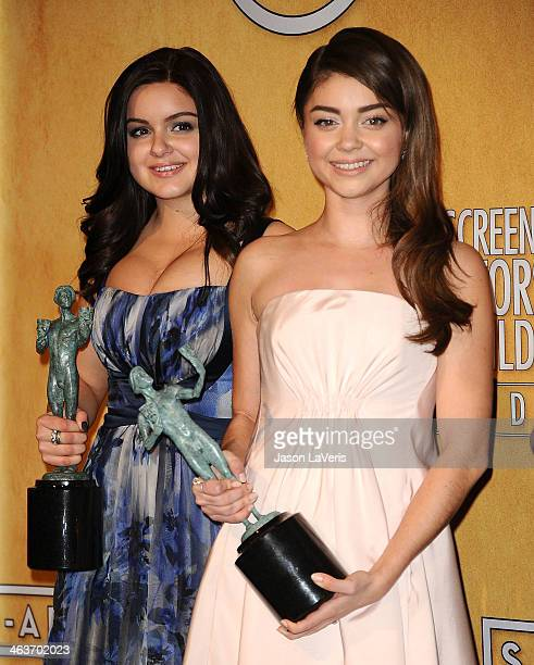 Actresses Ariel Winter and Sarah Hyland pose in the press room at the 20th annual Screen Actors Guild Awards at The Shrine Auditorium on January 18...