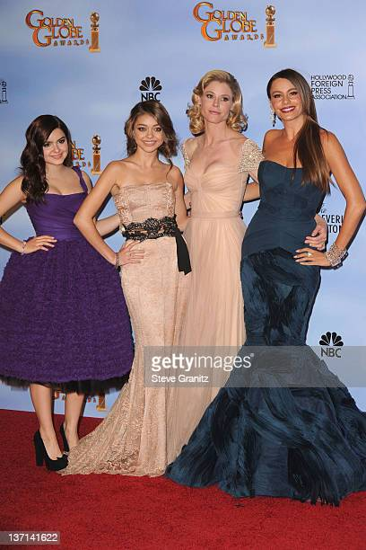 Actresses Ariel Winter Sarah Hyland Julie Bowen and Sofia Vergara pose in the press room at the 69th Annual Golden Globe Awards held at the Beverly...