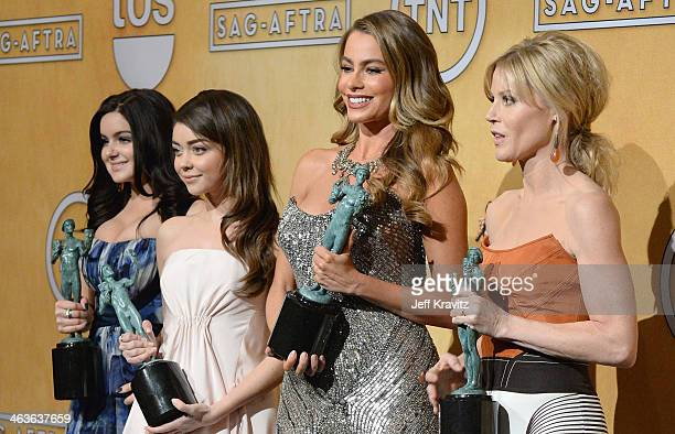 Actresses Ariel Winter Sarah Hyland Sofia Vergara and Julie Bowen pose in the press room during the 20th Annual Screen Actors Guild Awards at The...