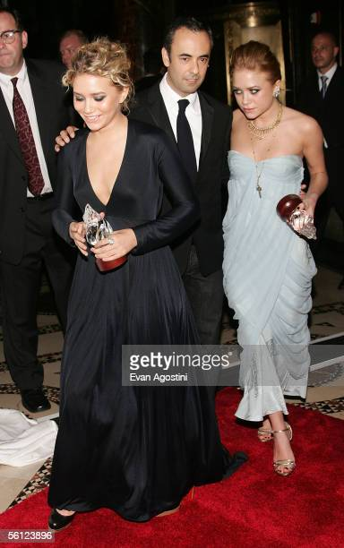 Actresses Ashley and MaryKate Olsen are seen with their presenter designer Francisco Costa and their 'Excellence Awards' at The Accessories Council...