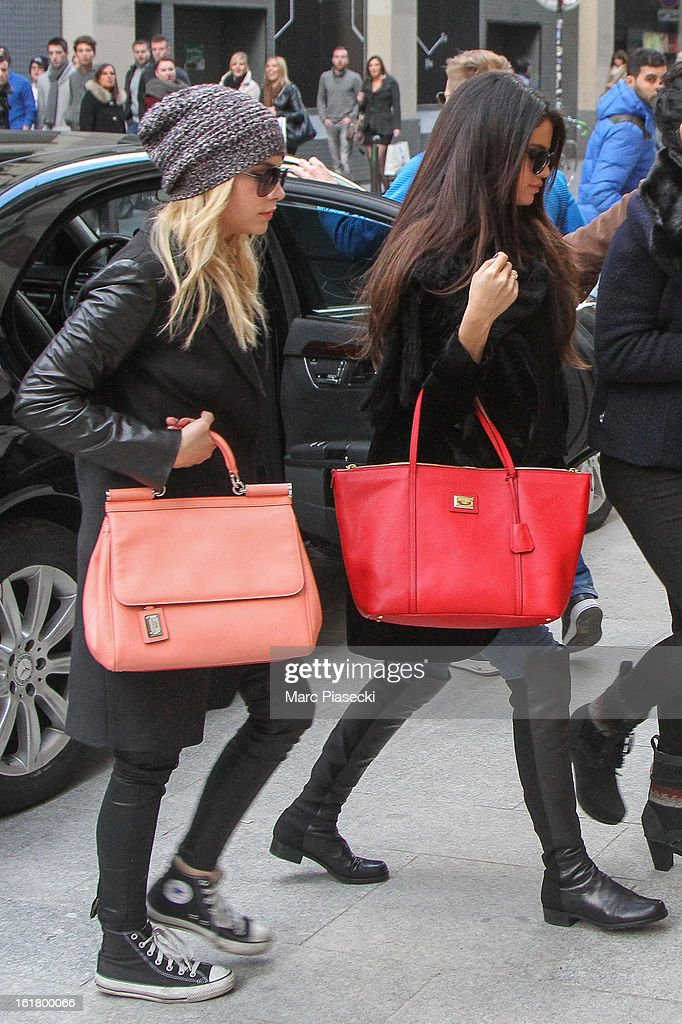 Actresses Ashley Benson and Selena Gomez arrive at the 'Printemps' department store on February 16, 2013 in Paris, France.