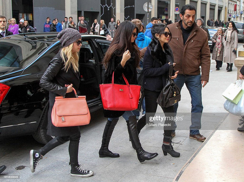 Actresses Ashley Benson, Selena Gomez and Vanessa Hudgens arrive at the 'Printemps' department store on February 16, 2013 in Paris, France.