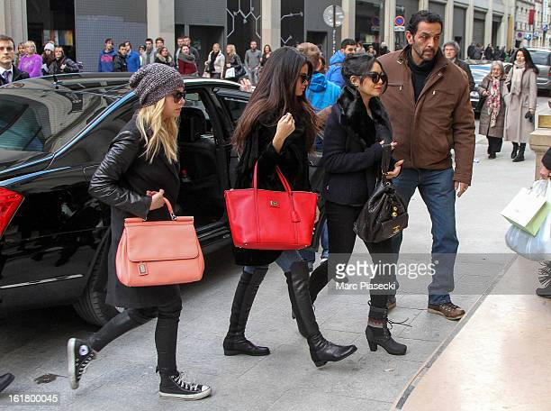 Actresses Ashley Benson Selena Gomez and Vanessa Hudgens arrive at the 'Printemps' department store on February 16 2013 in Paris France