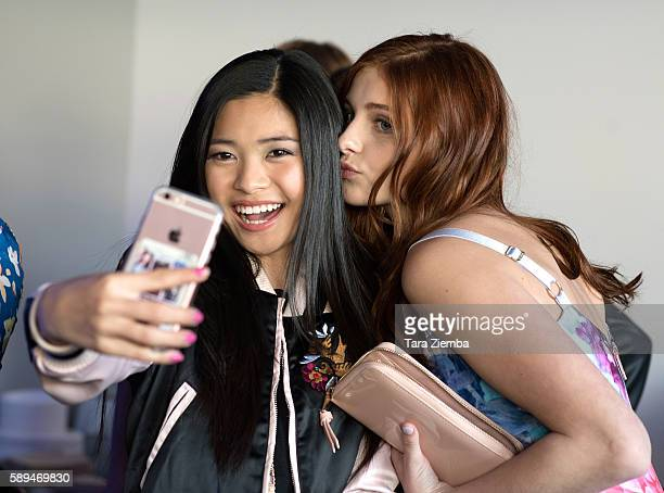 Actresses Ashley Liao and Jane Widdop take a selfie at Amazon and Tiger Beat Magazines premiere of The Kicks at StubHub Center on August 13 2016 in...