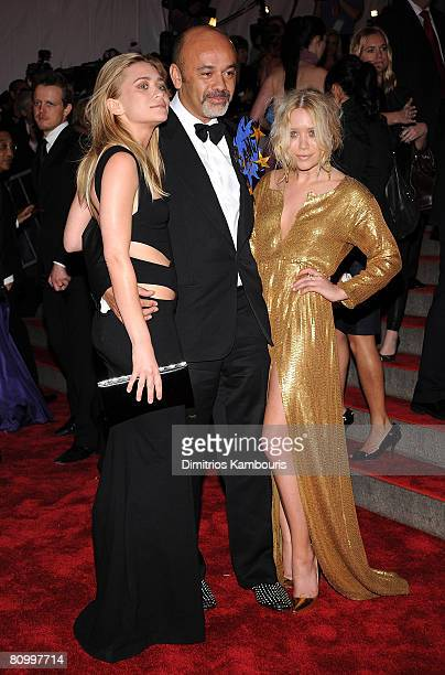 Actresses Ashley Olsen and Mary-Kate Olsen with designer Christian Louboutin attend the Metropolitan Museum of Art Costume Institute Gala...