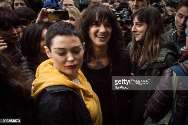 Actresses Asia Argento left and Rose McGowan pose during a demonstration to mark the international Women's Day in Rome Thursday March 8 2018 Asia...