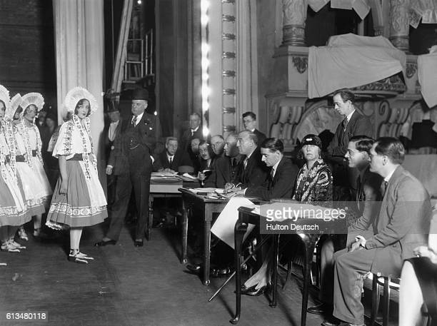 Actresses audition for a 1929 production of the play Wake Up and Dream Charles B Cochran producer stands on stage next to the actresses By John...