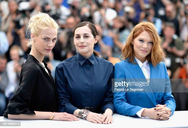 Actresses Aymeline Valade Amira Casar and Lea Seydoux attends the 'Saint Laurent' photocall during the 67th Annual Cannes Film Festival on May 17...