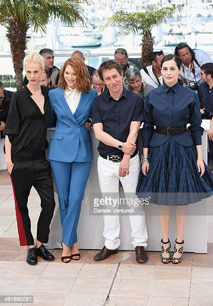 Actresses Aymeline Valade Lea Seydoux director Bertrand Bonello and actress Amira Casar attend the 'Saint Laurent' photocall at the 67th Annual...