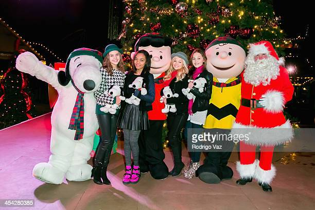 Actresses Bailee Madison China Anne McClain Olivia Holt and Kelli Berglund with characters Lucy Snoopy and Charlie Brown attend the Knott's Merry...