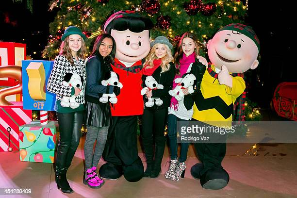 Actresses Bailee Madison China Anne McClain Olivia Holt and Kelli Berglund with characters Lucy and Charlie Brown attend the Knott's Merry Farm...