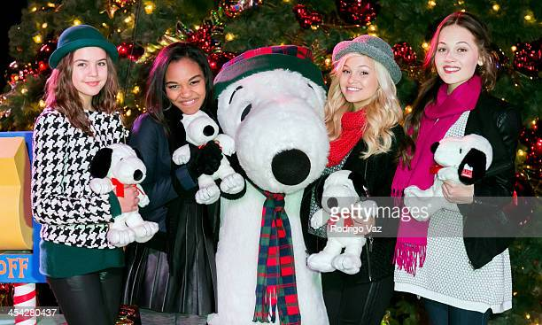 Actresses Bailee Madison China Anne McClain Olivia Holt and Kelli Berglund with character Snoopy attend the Knott's Merry Farm Holiday Reading and...
