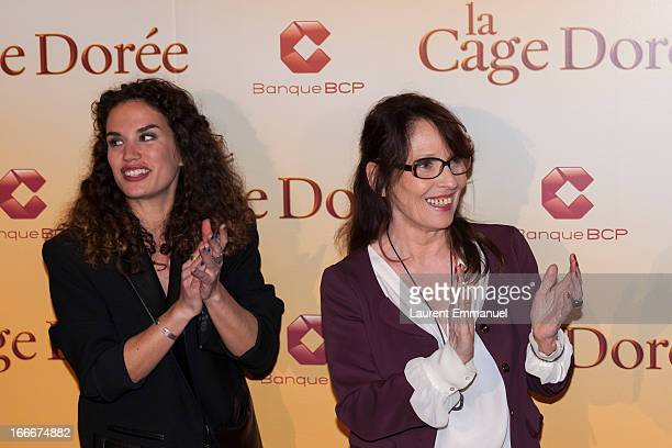 """Actresses Barbara Cabrita and Chantal Lauby pose during the premiere of the movie """"La Cage Doree"""" at Cinema Gaumont Marignan on April 15, 2013 in..."""