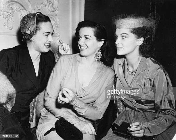 Actresses Beatrice Campbell Jane Russell and Lisa Daniels laughing together at a reception for the Royal Command Film Show at the Odeon Leicester...