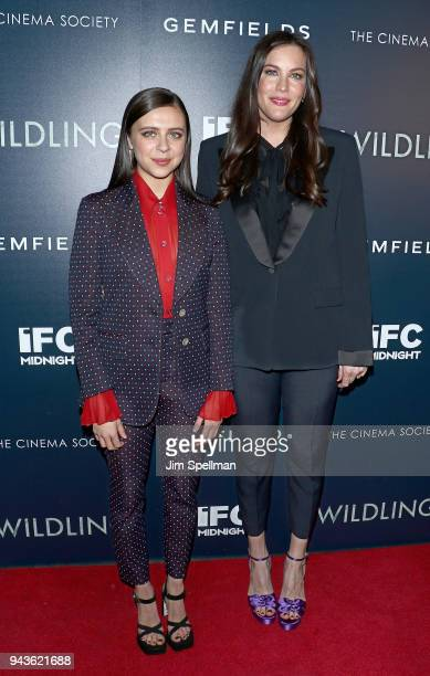 Actresses Bel Powley and Liv Tyler attend the screening of IFC Midnight's 'Wildling' hosted by The Cinema Society and Gemfields at iPic Theater on...