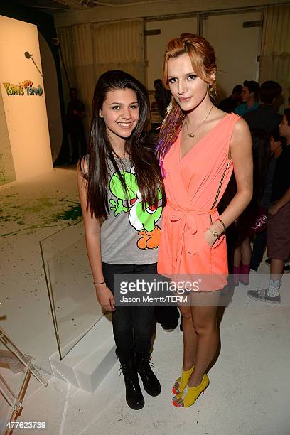 Actresses Bella Thorne and Amber Montana attend Yoshi's Celebrity Egg Decorating Eggsperience on March 9 2014 in Los Angeles California