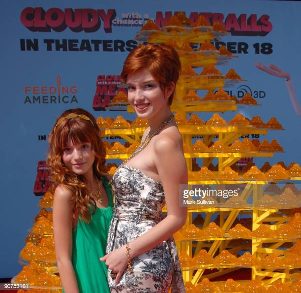 Actresses Bella Thorne and Dani Thorne pose in front of a JellO Castle at Mann Village Theatre on September 14 2009 in Westwood Los Angeles California