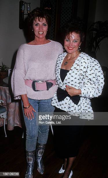 Actresses Beverly Sassoon and Carol Connors being photographed on May 26 1987 at Lalo and Brothers Restaurant in Los Angeles California