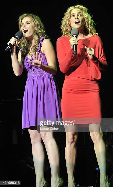 Actresses Brianna Brown and Alexis Carra perform onstage during the What A Pair Benefit Concert to support breast cancer research education programs...
