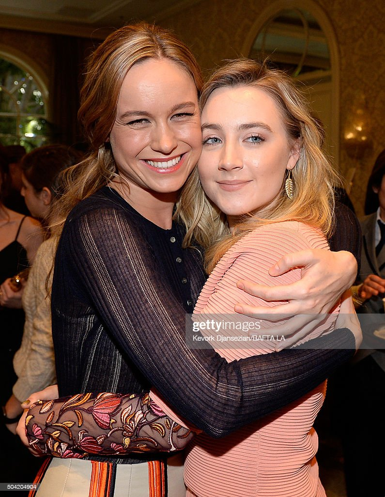 Actresses Brie Larson (L) and Saoirse Ronan attend the BAFTA Los Angeles Awards Season Tea at Four Seasons Hotel Los Angeles at Beverly Hills on January 9, 2016 in Los Angeles, California.