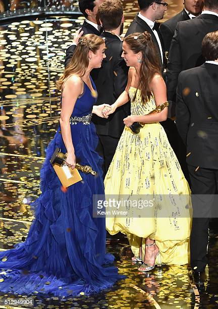 Actresses Brie Larson winner of Best Actress for 'Room' and Alicia Vikander winner of Best Supporting Actress for 'The Danish Girl' celebrate onstage...