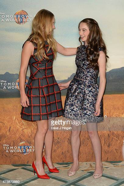 Actresses Britt Robertson and Raffey Cassidy pose during the Tomorrowland A World Beyond Photocall at Claridges Hotel on May 18 2015 in London England