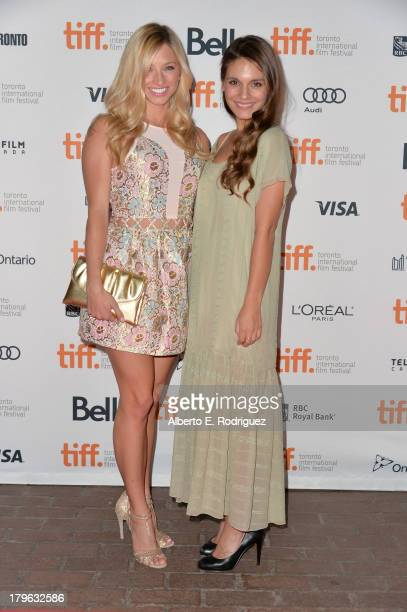 Actresses Brooke Butler and Caitlin Stasey arrive at the All Cheerleaders Die premiere during the 2013 Toronto International Film Festival at Ryerson...