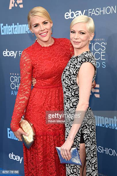 Actresses Busy Philipps and Michelle Williams attend The 22nd Annual Critics' Choice Awards at Barker Hangar on December 11 2016 in Santa Monica...