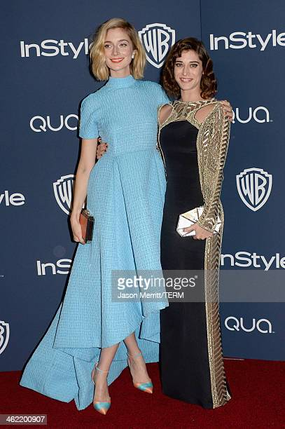 Actresses Caitlin FitzGerald and Lizzy Caplan attend the 2014 InStyle and Warner Bros 71st Annual Golden Globe Awards PostParty on January 12 2014 in...