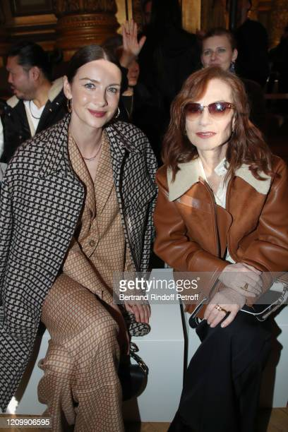 Actresses Caitriona Balfe and Isabelle Huppert attend the Stella McCartney show as part of the Paris Fashion Week Womenswear Fall/Winter 2020/2021 on...