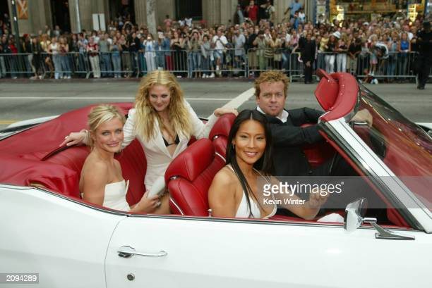 """Actresses Cameron Diaz, Drew Barrymore, Lucy Liu and director Mc G arrive to the premiere of Columbia Pictures' film """"Charlie's Angels 2: Full..."""