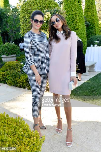 Actresses Camilla Belle and Ashley Madekwe attend the Victoria Beckham for Target Launch Event on April 1 2017 in Los Angeles California