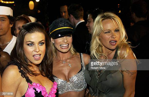 Actresses Carmen Electra Jaime Pressly and Pamela Anderson attend the official launch party for Spike TV at the Playboy Mansion on June 10 2003 in...