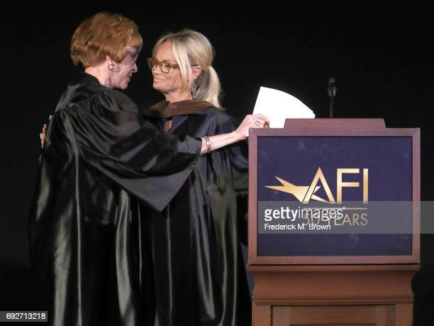 Actresses Carol Burnett and Kristin Chenoweth speak during AFI's Conservatory Commencement Ceremony at the TCL Chinese Theatre on June 5 2017 in...