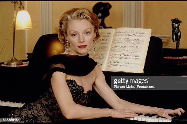 Actresses Caroline Sihol Sitting at Piano