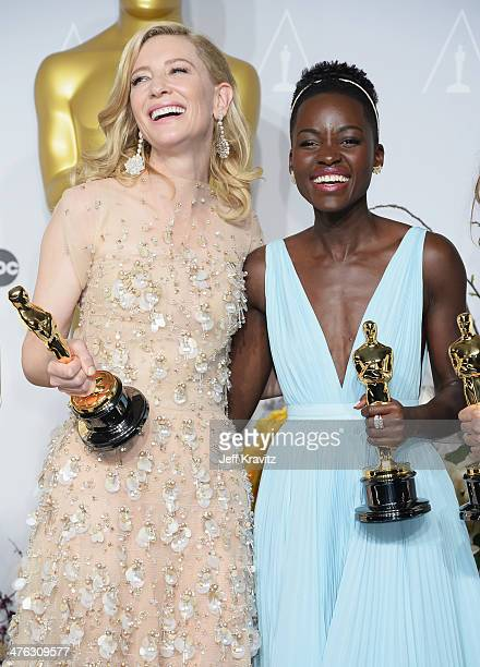 Actresses Cate Blanchett and Lupita Nyong'o pose in the press room during the Oscars at Loews Hollywood Hotel on March 2 2014 in Hollywood California