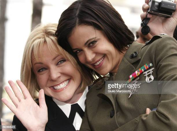 Actresses Catherine Bell and Sasha Alexander attend a Star On The Walk Of Fame ceremony for Donald P Bellisario March 2 2004 in Hollywood California