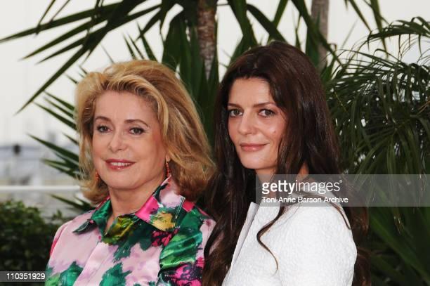 Actresses Catherine Deneuve and Chiara Mastroianni attend the Un Conte de Noel photocall at the Palais des Festivals during the 61st Cannes...