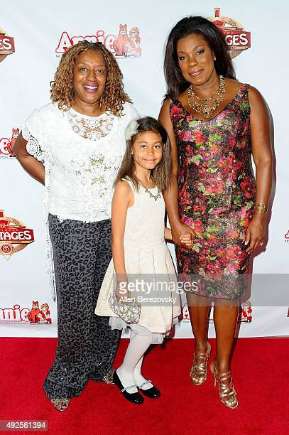 Actresses CCH Pounder Lorraine Toussaint and her daughter Samara Grace attend the Premiere of Annie at the Hollywood Pantages Theatre on October 13...