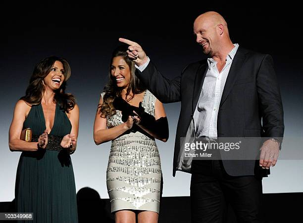 Actresses Charisma Carpenter and Giselle Itie and actor Steve Austin are introduced at a screening of Lionsgate Films' The Expendables at the Planet...