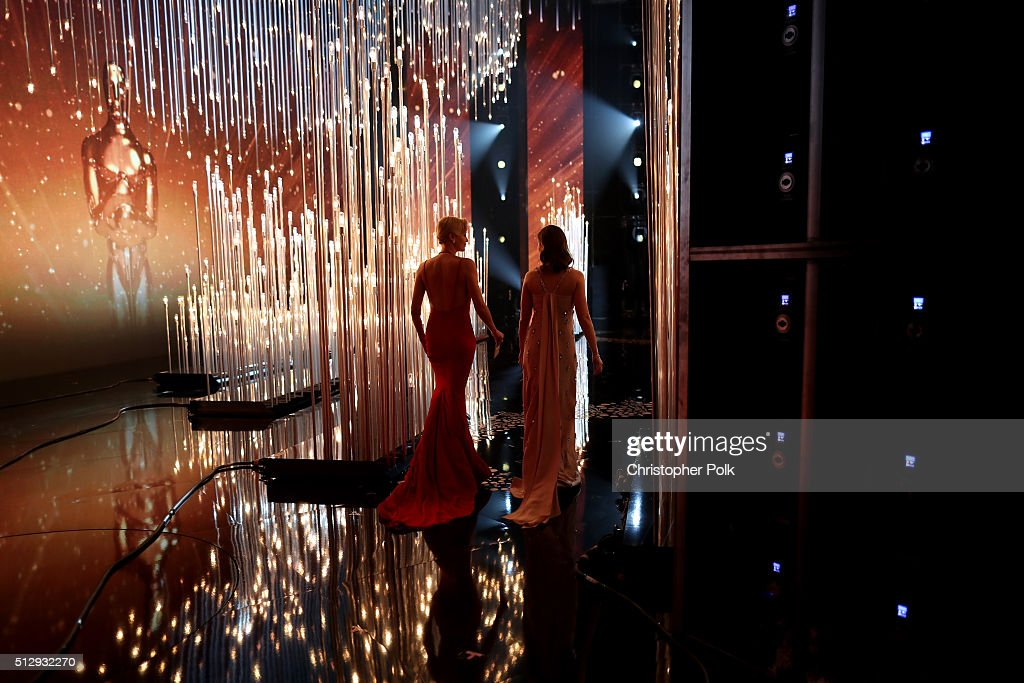 Actresses Charlize Theron (L) and Emily Blunt walk onstage at the 88th Annual Academy Awards at Dolby Theatre on February 28, 2016 in Hollywood, California.